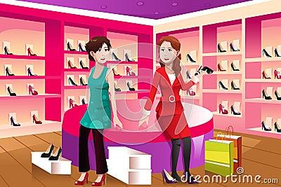 Duas mulheres que compram sapatas