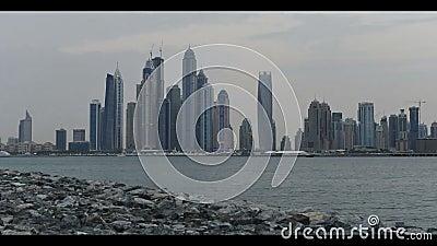 Dubai city skyline. Time lapse video clip of Dubai city marina skyline changing from dusk to night, UAE