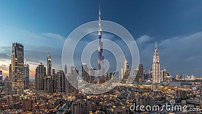 Dubai Downtown skyline dag-tot-nacht met Burj Khalifa en andere towers paniramische uitzicht vanaf de top in Dubai stock footage