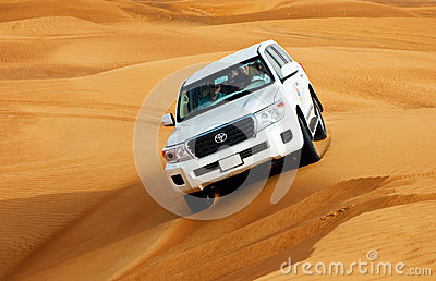 DUBAI - JUNE 2: Driving on jeeps on the desert, traditional entertainment Editorial Stock Image