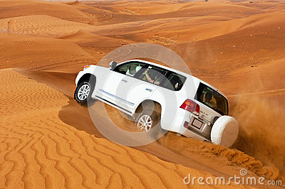 DUBAI - JUNE 2: Driving on jeeps on the desert, traditional Editorial Photography
