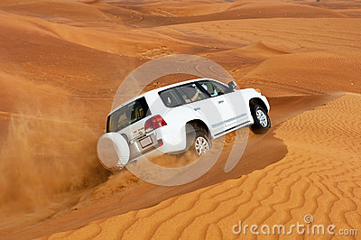 DUBAI - JUNE 2: Driving on jeeps on the desert, traditional entertainment Editorial Stock Photo