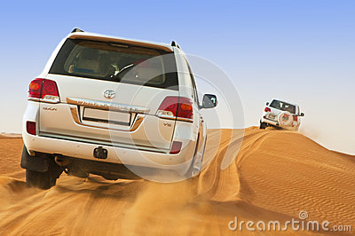 DUBAI - JUNE 2: Driving on jeeps on the desert, traditional entertainment for tourists Editorial Image
