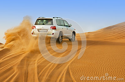DUBAI - JUNE 2: Driving on jeeps on the desert, traditional entertainment Editorial Photography