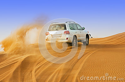 DUBAI - JUNE 2: Driving on jeeps on the desert, traditional Editorial Stock Photo