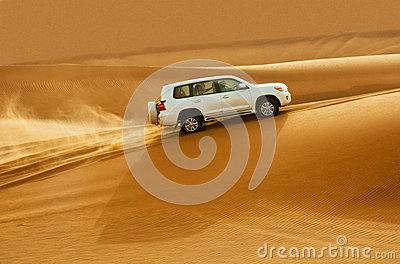 DUBAI - JUNE 2: Driving on jeeps on the desert Editorial Stock Image