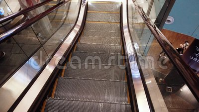 Dubai, United Arab Emirates - April 17, 2019: First person view of taking  the stairs in Dubai mall