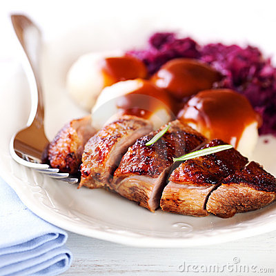 Duck breast with potato dumplings and red cabbage