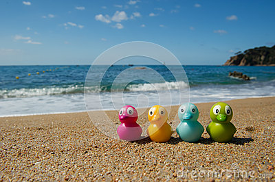 Duck toys at the beach