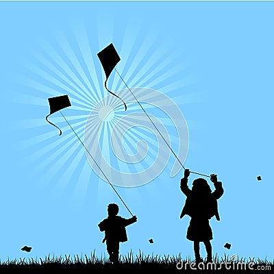 Due bambini che giocano con i cervi volanti