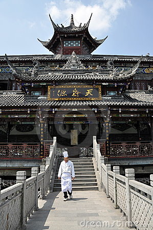 Dujiangyan, China: Chef on Yang Tian Wo Bridge Editorial Image