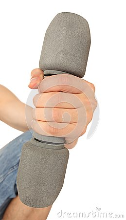 Dumbbell lifted by man s hand