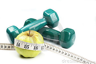Dumbbells and the apple with measuring tape