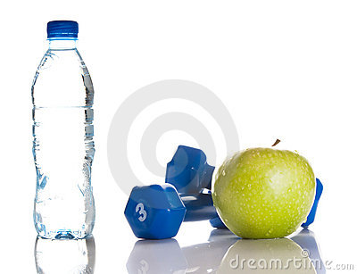 Dumbbells, green apple and a bottle of fresh water