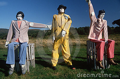 Dummies in colorful suits in field Editorial Photography