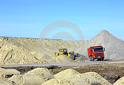 Dump truck and bulldozer