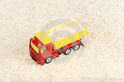 Dump truck toy transported rice grains