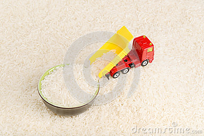 Dump truck toy unload rice grains to plate
