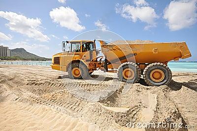 Dump trunk full of sand on a beach