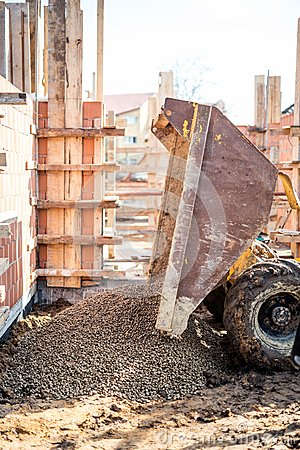 Free Dumper Truck Unloading Construction Gravel, Granite And Crushed Stones At Building Foundation Stock Photos - 51031133