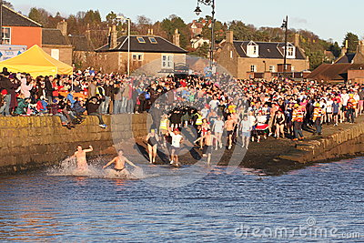 Dundee, UK - January 1: Swimmers taking part in the New Years Day Dook in Broughty Ferry Harbour Dundee on January 1st 2013. Every Editorial Image