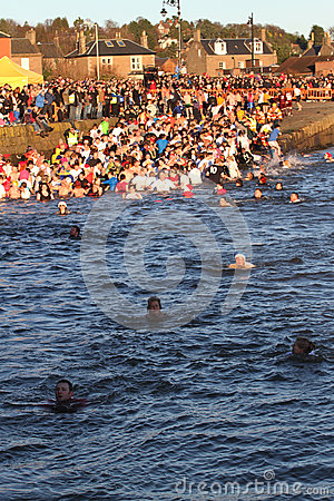 Dundee, UK - January 1: Swimmers taking part in the New Years Day Dook in Broughty Ferry Harbour Dundee on January 1st 2013. Every Editorial Photo