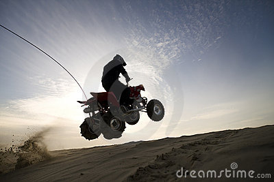 Dune atv jump in the sunset