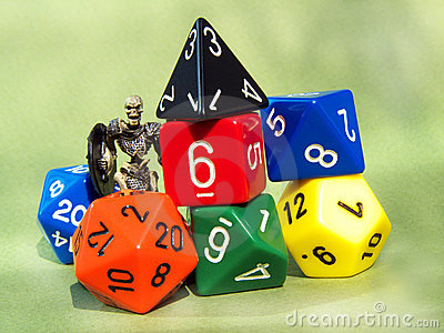 Dungeons & Dragons dices and skeleton miniature