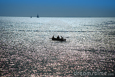 Dusk over sea, fishermen