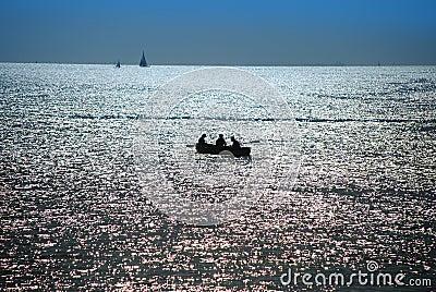 Dusk over sea, fishermen