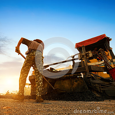 Free Dusk, Road Workers Are Working. Royalty Free Stock Photo - 35324455