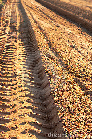 Dusty gravel road with imprint