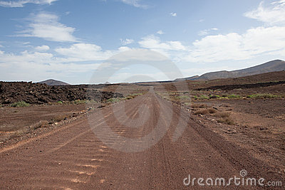 Dusty road through desert