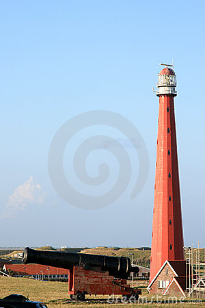 Dutch canon and lighthouse near Huisduinen