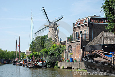 Dutch cityscape Gouda with canal-windmill-ships