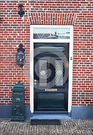 Free Dutch Front Door With Mailbox And Lantern. Brick House Stock Images - 88709074