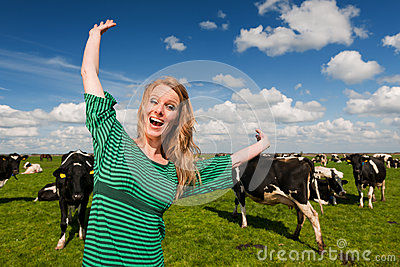 Dutch girl happy in field with cows
