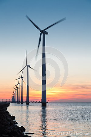 Free Dutch Row Offshore Wind Turbines At Beautiful Sunset Royalty Free Stock Photos - 40871188