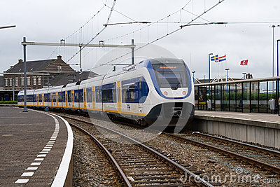 A Dutch train prepares to leave the Hook of Holland Station Editorial Stock Photo