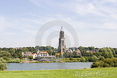 Dutch village with church on riverfront