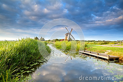 Dutch windmill and blue morning sky