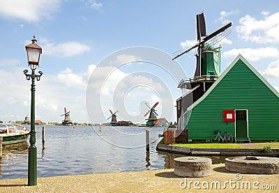 Dutch windmills over river in Zaanse Schans