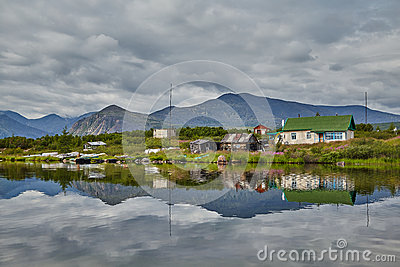 Dwelling of meteorologists on island. Reflexion in water. Jack London s lake. Kolyma