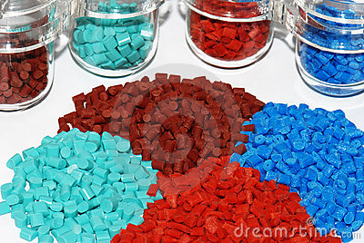 Dyed plastic granulate in test glasses
