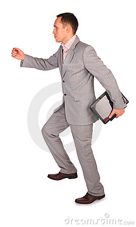 Dynamic businessman with notebook