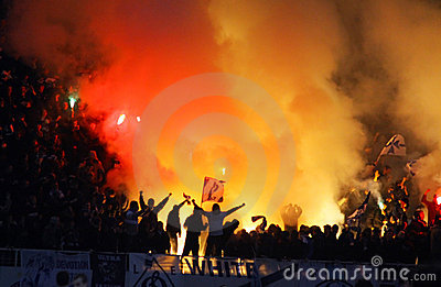 Dynamo Kyiv supporters burn flares Editorial Photo