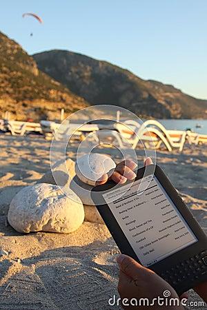 E-Reader on Beach Editorial Photography