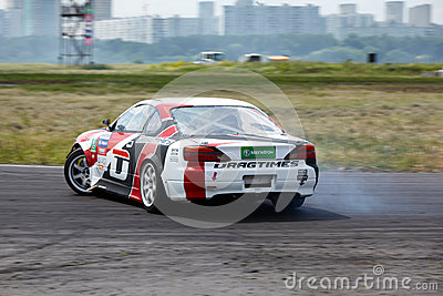 E.Satyukov racing car on track in 3-d tour Editorial Image