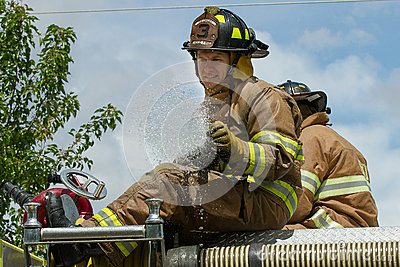 EAGLE/IDAHO - JUNE 9: Fireman on top of his firetruck after he just opened his firehose during the Eagle Fun days in Eagle, Idaho Editorial Photo