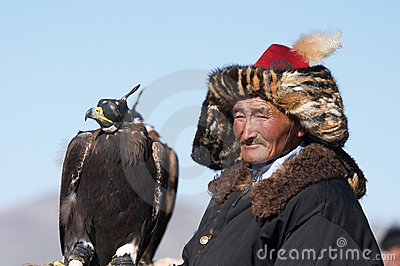 Eaglehunter with golden eagle Editorial Stock Image